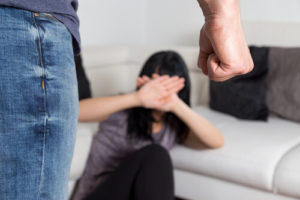 woman trying to protect herself from a domestic violence